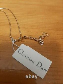 Vintage Christian Dior Symbol Necklace Gold Plated with Emerald Crystal and Tags